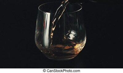 Pouring drink into a glass. Close up