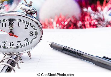 pen on New Year's diary - black fountain pen lying on the...