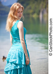 Young blond woman in blue dress