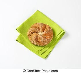 fresh whole wheat bun - fresh bun on green place mat