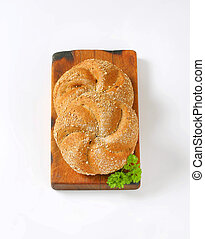 whole wheat buns - two whole wheat buns on wooden cutting...