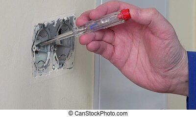 Electrician test power on wall socket - Electrician hands...