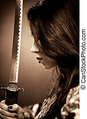 Young woman with samurai sword Sepia color