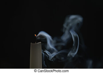 tall candle with smoke trail in the dark environment,...