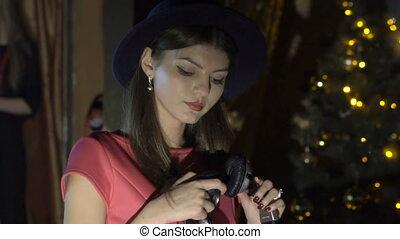 Glamorous girl dancing with DJ's headphone in night club....