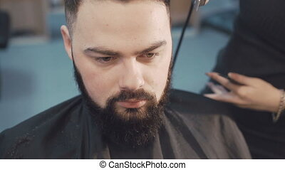Barber shaving the whiskers in the barbershop