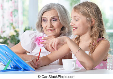 grandmother with her granddaughter - Portrait of a...