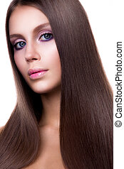 Beauty Woman with Very Long Healthy and Shiny Smooth Brown Hair.