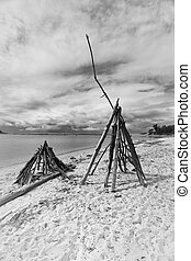 Driftwood TeePees - Driftwood teepees on the beach in summer