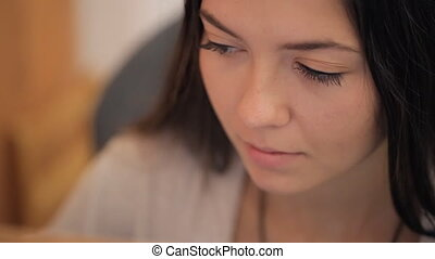 Portrait of young beautiful brunette. top view of her face....