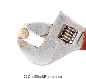 herbal pill on adjustable pliers pipe wrench