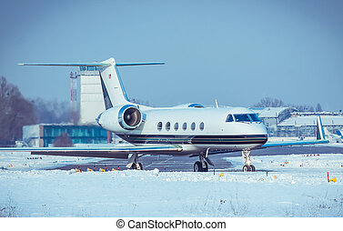 Business jet on runway - Business jet in the airport on a...
