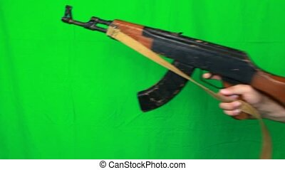 Holding Ak47 Finger On A Trigger - Holding a finger on ak-47...