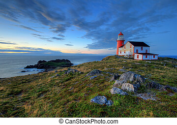 Lighthouse - Rocky coastline with lighthouse.