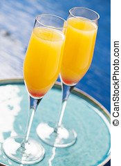 Mimosa cocktail - Two glasses with mimosa cocktail (cave...