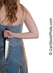 closeup woman with knife behind her back - isolated 1940s...