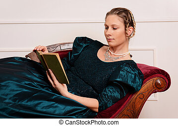 victorian woman laying on couch reading book - portrait of...