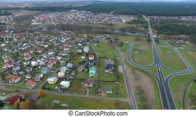 Flight Over The Forest And Small Town In Distance 6 - Aerial...
