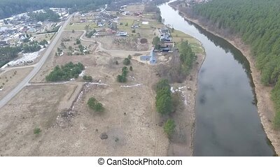 Flight Beyond River Over Small Town - Aerial HD High Quality...