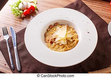 Pasta spaghetti carbonara on white background. Top view -...