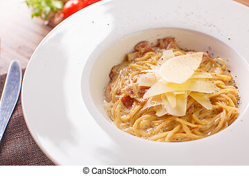 Pasta spaghetti carbonara on white background. Top view -...