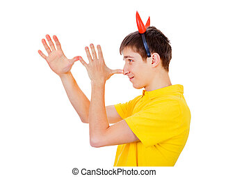 Young Man with Devil Horns gesturing Isolated on the White...
