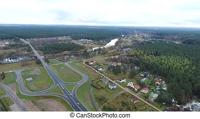 Flight Over The Forest And Small Town In Distance 4 - Aerial...