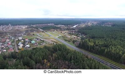 Flight Over The Forest And Small Town In Distance 3 - Aerial...