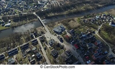 Flight Over Small Town Near River - Aerial HD High Quality...