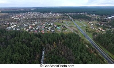 Flight Over The Forest And Small Town In Distance 5 Aerial...
