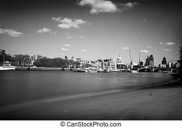 view of the financial district in london across the thames -...