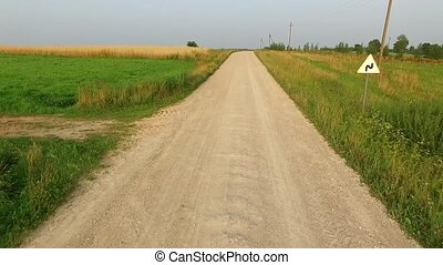 Flight Beyond Gravel Road And Over Meadow In Countryside -...