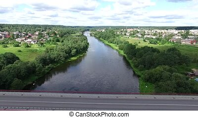 Landing Over The Bridge Above River And Small Town In...