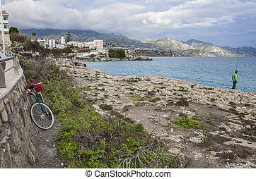 Rod fisher near Balcon de Europa, Nerja, Spain - Rod fisher...