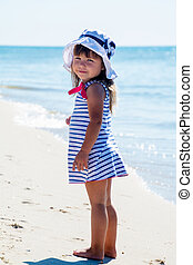 Little girl walking along beach - Adorable little girl...