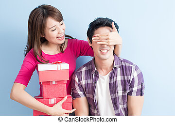 young couple with gift
