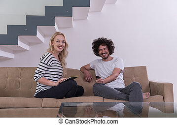 couple relaxes in the living room