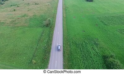 Flying Over Country Road, Car Passing By