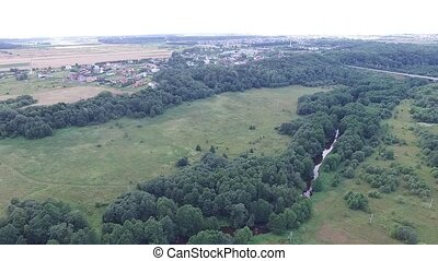 Flight Over Meadow Near Forest And River, Small Town In...