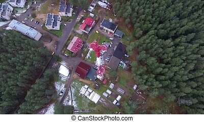 Vertical Flight Over Tv Tower, Houses And Forest - Aerial HD...