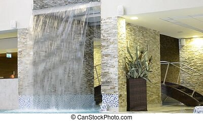 Decorative waterfall - water falls down with glass roof....