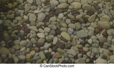 Stones, pebbles, and granite on bottom in relaxation pool