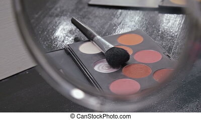 Professional makeup brush and eyeshadows palette, closeup