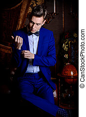 luxurious lifestyle - Imposing well dressed man in a...