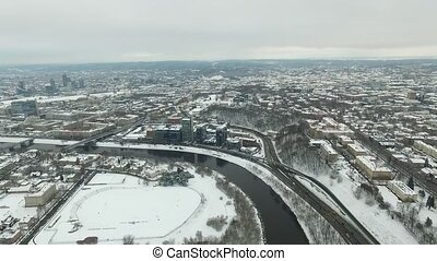 Aerial View Over The City Near River, Winter 2