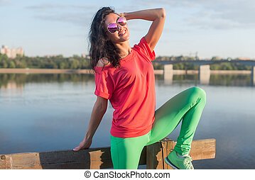 Smiling summer woman wearing sunglasses near river. -...