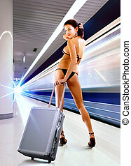 sexy woman with luggage in subway - beautiful sexy woman in...