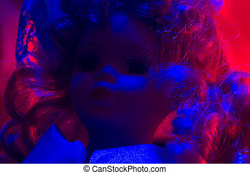 Horror doll blue & red light. - Creepy horror photo of a...