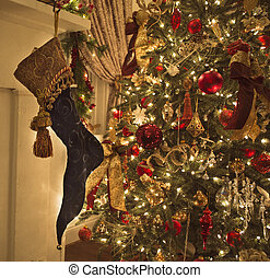 Christmas tree and stocking hanging on a hearth