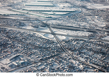 Road junction aerial view at winter